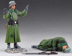 World War II German Winter SS013B Dead & Surrendering German - Made by Thomas Gunn Military Miniatures and Models. Factory made, hand assembled, painted and boxed in a padded decorative box. Excellent gift for the enthusiast.