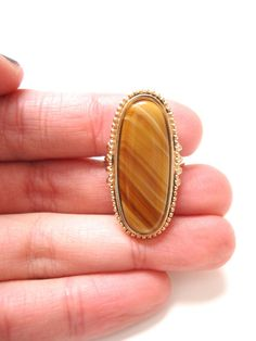 Hey, I found this really awesome Etsy listing at https://www.etsy.com/listing/177424841/vintage-avon-ring-butterscotch-vintage