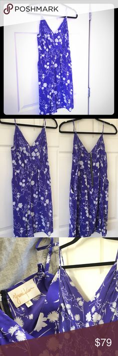 Yumi Kim Floral Silk Dress Gorgeous purple-blue floral printed silk dress by Yumi Kim. Crossover bust, exposed zipper in back, adjustable straps, and two front pockets! Light and flowy! Worn a couple of times. Has a few small dark spots near the hemline on left and right sides, but easy to miss given the floral print. Purchased from Bloomingdales. Yumi Kim Dresses Mini