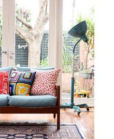 Colouful pillows for sixties charme sofa - love that.  - Farbenfrohe Kissen für eine Couch im 60er Jahre Teak-Flair - einfach schick! http://www.teenagewasteland.de/einrichtung/s_danish_design.html