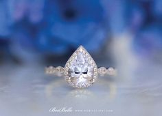 2-set: https://www.etsy.com/listing/448784758/293-cttw-art-deco-bridal-set-ring-pear?ref=shop_home_active_2  Engagement ring alone: https://www.etsy.com/listing/263895786/270-cttw-art-deco-ring-halo-engagement?ref=shop_home_active_6  All eternity band alone: