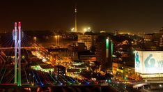 Johannesburg, Gauteng, South Africa - A colourful display of nighttime traffic between buildings in the mid city centre of Johannesburg. City Scene, Night Time, Stock Footage, South Africa, Centre, Buildings, Display, Google, Travel