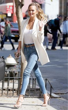 Chrissy Teigen in a white boyfriend blazer instantly elevates a simple jeans & tee look. Keep it casual & clean with a ponytail & your favorite nude heels. #womenwear