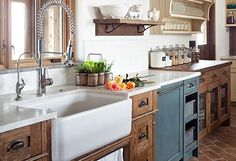 Just love this kitchen - the farmhouse sink, rustic cabinets with a splash of color.  Beautiful!