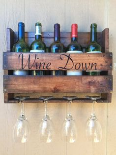 **********Please note: All orders taken after December 1st may need to be fulfilled after January 1st 2018.***************** Display your wine in this beautiful wooden wall rack. Rack comes with 2-4wine glass holders and holds up to 2-5 wine bottles. Our Rustic Wine Rack is