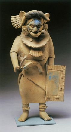 SUPPORTING IMAGE 2 Goddess O, also called Chak Chel. Maya Culture, Jaina Island, 600-800, ceramic. This figure shows the same goddess, under a different name, in one of her many other forms. Here she is a warrior, still with traces of blue pigment and a headdress, but instead she is clothed and standing as if ready for battle.