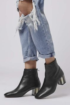 Photo 2 of MUSIC Bone Heel Ankle Boots