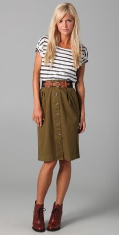 I love the silhouette of this outfit and the olive skirt with giant button paired with the stripes.