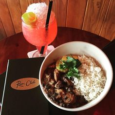 New food special up in da club! Feijoada: Brazilian pork stew with black beans and rice! Pictured with the delicious Faster Pussycat cocktail.