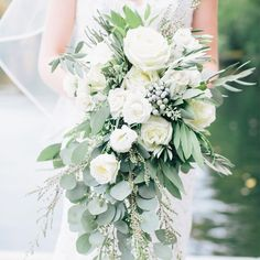 "A friend of the bride's mother helped create all the floral arrangements for the wedding. ""I wanted all the bouquets to look very lush and like they could have been picked out of a garden with lots of greens,"" Whitney says."