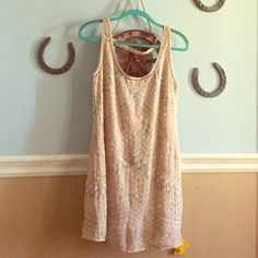 Free People dress, worn once, in great condition A cream dress with beading and light color stitching. Perfect for dances or a night out. Still looks brand new. I'm 5'5 and it falls a little above the knee. Free People Dresses