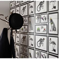 Love this quirky Holden mad dogs wallpaper. It's aims to present British eccentricities and does so with style.