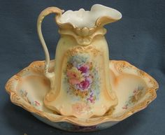English ironstone pitcher and bowl with cream and red rose decoration, 18 x 15 (bowl), 13 high (pitcher)