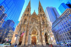 Patrick's Cathedral is located at the avenue in New York City. It is the biggest church in the United States. The Gothic Catholic church is where the archbishop of New York holds its seat Rockefeller Center, Hotel San Francisco, St Patricks Cathedral Nyc, Places To Travel, Places To See, Catholic Churches, Roman Catholic, Sainte Sophie, New York