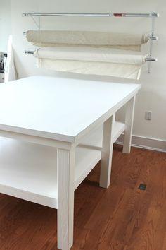 studio printing table is done-for sewing and crafts room...rack for rolls of military fabric would be great made out of wood..