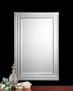 """The winner!  I love how this mirror works with the pendant and how it complements the pedestal sink.  Closing in . . . love steped bevels!    Uttermost Alanna, Vanity #08027 B    This frameless mirror is constructed of stepped, bevel mirrors with polished edges for a smooth, clean finish. Center mirror has a generous 1 1/4"""" bevel. May be hung either horizontal or vertical.    Designer:NA  Dimensions:22 W X 34 H X 2 D (in)  Weight (lbs):36  Ship Via UPS:Yes  UPC Number:792977080276"""