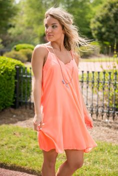 If you are anything like you change your mind... a lot! But one thing we haven't changed our mind about is how much we love this dress! We are all about some bright colors for summer!  Material has no amount of stretch.  Judith is wearing the small. Sizes fit: Small- 0-4; Medium- 6; Large- 8-10