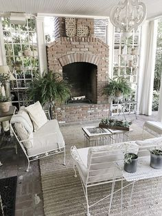 Fixer upper farmhouse back porch ideas. The back porch is used just like another room in our home. With the fireplace and heaters in the ceiling, we use the room year round. #fixerupper #backporch #homedecor #ideas Beautiful Homes of Instagram @my100yearoldhome