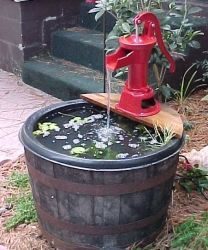 This beautiful barrel fountain is made with a vintage Kentucky Bourbon whiskey barrels half. Just add a pump, and in this case a cast iron hand pump, and you have a soothing addition to your deck, patio, yard, or garden.