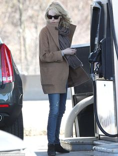 second-day waves, black wayfarers, camel coat, oversized thin tan scarf, jeans and black shoe-boots