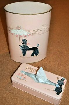 Poodle-patterned bathroom waste basket/Kleenex box cover. Poodle designs were ubiquitous when I was a kid, lol.