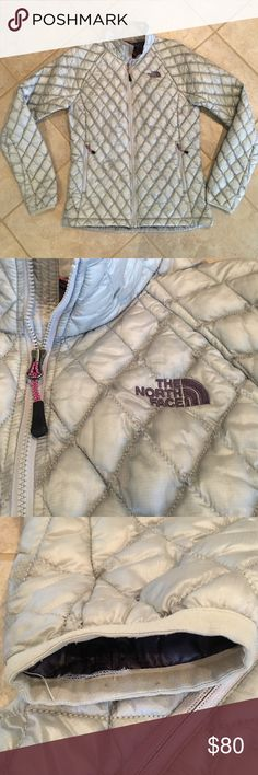 🍂 The North Face Thermoball Jacket Size S This jacket has been lightly worn but is in great used condition. Only sign of wear is at the cuffs of the sleeves, as seen in third photo. Extremely lightweight, not too puffy, and very warm. Medium grey/silver color with dark purple lining and pink accents at zipper pulls.  Smoke free home. No trades, holds, outside sales, or lowball offers. The North Face Jackets & Coats