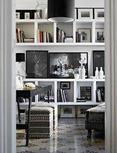 chic, modern white bookcase with black & white photography #bookshelves #modern