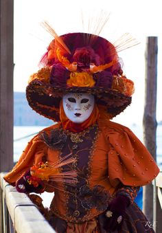Orange Masquerade by Jose Luis Rubianes. Venice carnival has a long and storied past and you can see influences of the Renaissance in the incredible costumes you will see
