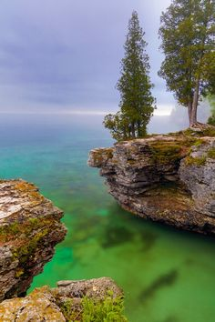 Misty Morning at Cave Point - The rocky Lake Michigan coast of Door County, Wisconsin's Cave Point is displayed with early morning fog.