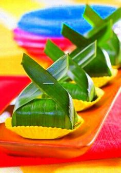 Lemper, rice mix with coconut, chicken inside and banana leaf covered.