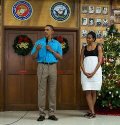 On Christmas day, President Obama & First Lady Michelle visited military personnel at Marine Corps Base Hawaii in Kaneohe Bay, Hawaii.  Mrs. Obama wore a black & white Narciso Rodriguez dress, which first debuted in July 2009. Note the polish: neon toes added a pop of color!