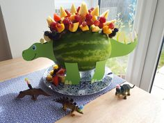 Dinosaur fruit kebab party melon I had seen lots of cool carved t-rex fruit kebab holders but I desi Watermelon Birthday Parties, 3rd Birthday Parties, Birthday Party Decorations, Birthday Ideas, Backyard Birthday, Dinosaur Birthday Party, Dinosaur Watermelon, Fruit Kebabs, Third Birthday