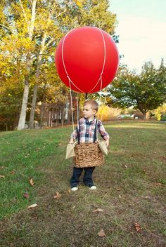 Homemade Hot air balloon costume. My husband and I made this last year using a wicker basket, a large balloon filled with helium scrap fabric, string and flat canvas straps.