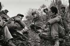 During the Battle of Pino del Agua, Fidel Castro and Che Guevara talk to a fellow rebel, who had just come from spying on Batista's troops, in the Sierra Maestra mountains, Cuba, 1958. Read more: http://lightbox.time.com/2013/10/01/enrique-meneses-on-the-frontier-of-history/#ixzz2gcm5RIp4