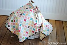 Car Seat Canopy Tutorial - The Ribbon Retreat Blog  I'm going to make one without the bows and with a different fabric.