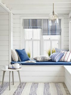 Home Buys to Embrace the Coastal Interiors Trend A bright and airy window seat in a beach house living room. Coastal Bedrooms, Coastal Living Rooms, Coastal Homes, Living Room Decor, Coastal Farmhouse, Coastal Cottage, Farmhouse Plans, Decor Room, Modern Farmhouse
