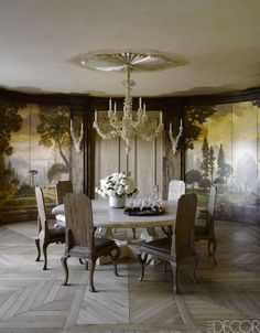 The limestone dining table, bought at the auction of Dodie Rosekrans's estate, is by Michael Taylor, as are the chairs, which are upholstered in a cowhide by Rose Tarlow Melrose House; the French chandelier is from Stéphane Olivier, the walls and ceiling feature a hand-painted mural, and the floor is French oak.   HOUSE TOUR: A Designer Revives A Faded 19th-Century Landmark