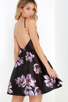 When the night sets in, make sure you're blossoming to your full potential in the Botanical Bliss Black Backless Floral Print Dress! Medium-weight, black woven fabric (with a painterly purple and ivory floral print) flows from thin straps to an apron neckline and darted bodice with open back. Voluminous skater skirt takes shape below the fitted waistline. Hidden back zipper with clasp.