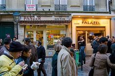 Paris, France  Where to Eat: By day, sidewalks in the Left Bank's Latin Quarter around Saint Michel get crowded with sandwich vendors selling baguettes. In the Marais, you'll want to try the falafel stands on Rue de Rosiers. At night, the air is filled with the aroma of freshly prepared crêpes, especially around Montparnasse, in the Latin Quarter, and near the nightclub areas.  How Much: A Nutella or chestnut-puree crêpe will cost about €4; a jambon et fromage baguette is around €6.