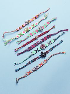 A collection of embellished friendship bracelets ready to share with your BFFs