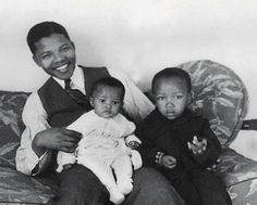 Vintage photo of Nelson Mandela and his sons.