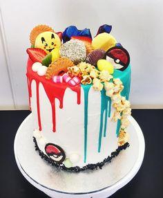 Gotta catch 'em all! Earl grey and lemon vanilla cake six layers high with Oreo pokeballs and Pikachu lemon macarons.