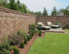 Beautiful brick fence with potted plants on top and awesome