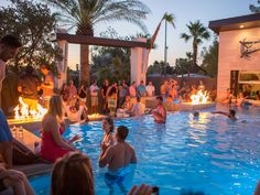 Guests enjoy the pool at Drew and Jonathan Scott's housewarming party in Las Vegas, as seen on HGTV's Property Brothers at Home.