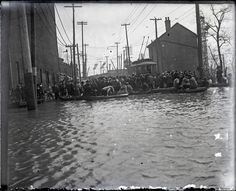 Cincinnati, Ohio, likely during the 1913 flood, glass plate negative from a private collection: A streetcar, boats, and a large crowd assembled at the edge of flood waters, unidentified location.