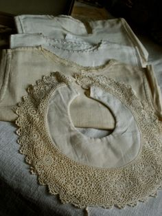 antique baby clothes and bib