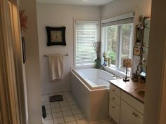 A jetted tub with a private view of your beautiful wooded lot in Leelanau County. Jetted Tub, Traverse City, Corner Bathtub, Floor Plans, Real Estate, Flooring, House, Beautiful, Whirlpool Tub