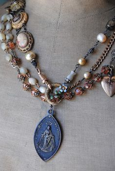 Love the eclectic combo of vintage beads and period statement pieces. (no help at site)