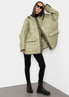 """Color: Moss Green Quilted nylon Boxy oversized silhouette Contrast piping and trim Flap front pockets Split cuffs Button front closure Curved slit hem Unlined 100% Polyester Dry Clean By The Frankie Shop. Imported One Size Product Measurements: 26"""" Shoulder 66"""" Bust 31"""" Length Bomber Coat, Oversized Jacket, Green Jacket, Ma 1 Jacket, Down Coat, Quilted Jacket, Mannequin, Winter Jackets, Clothes For Women"""