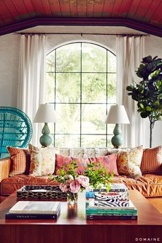 Living room with turquoise chair and colorful sofa